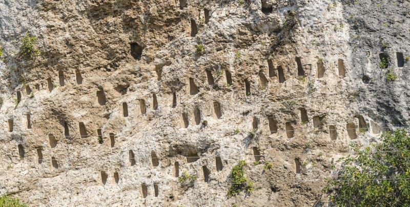 Rock niches near Dolno Cherkovishte village. The rock niches in the array Kovan Kaya Bee Stone near Dolno Cherkovishte village - place of the thracian religious royalty free stock photography