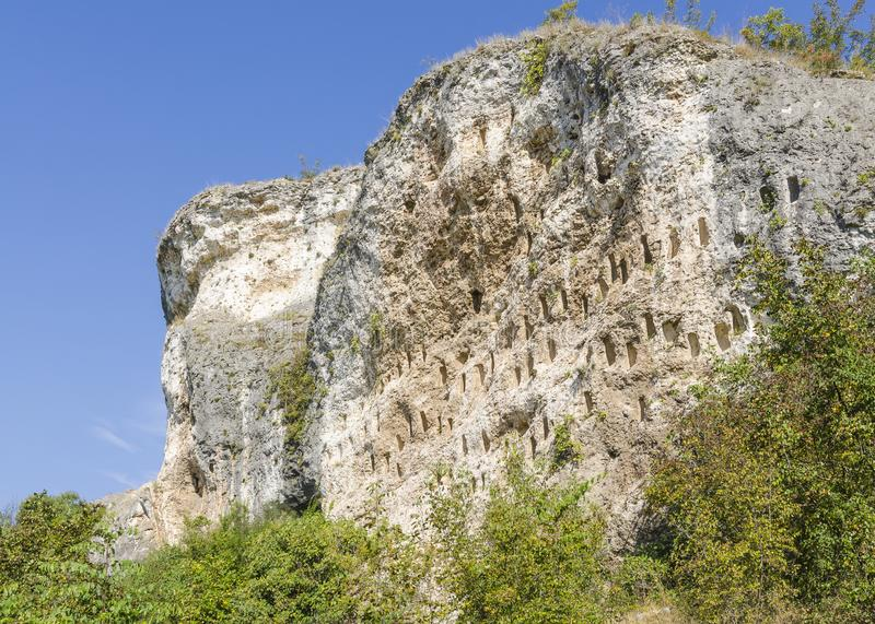 Rock niches near Dolno Cherkovishte village. The rock niches in the array Kovan Kaya Bee Stone near Dolno Cherkovishte village - place of the thracian religious royalty free stock images