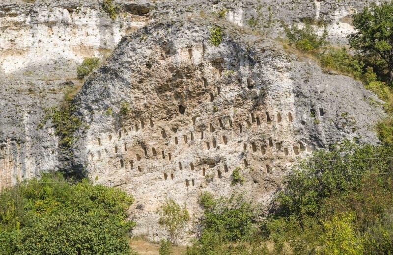 Rock niches near Dolno Cherkovishte village. The rock niches in the array Kovan Kaya Bee Stone near Dolno Cherkovishte village - place of the thracian religious royalty free stock photo