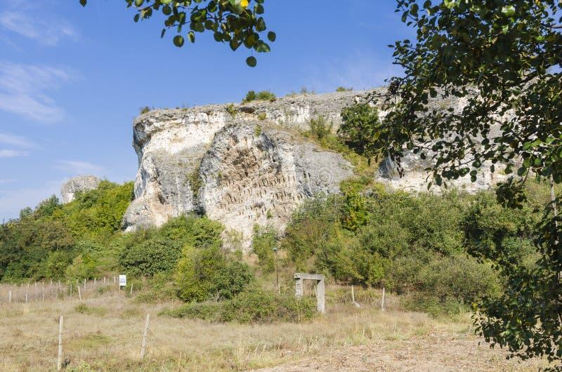 Rock niches near Dolno Cherkovishte village. The rock niches in the array Kovan Kaya Bee Stone near Dolno Cherkovishte village - place of the thracian religious royalty free stock photos