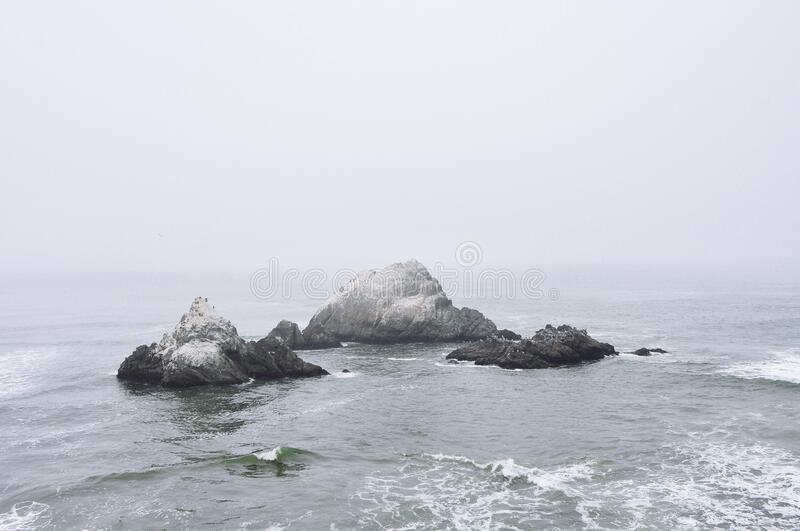 Rock Outcrops in Stormy Ocean royalty free stock image