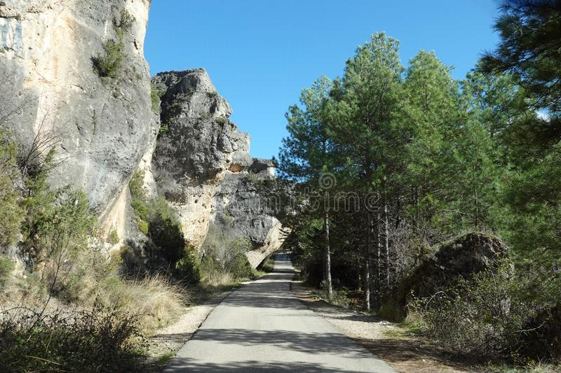 Rock covering small road to viewpoint of Cuenca town in Spain stock image