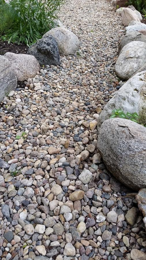 Rock Path. A pathway made of rock with bigger rocks on the outside stock images