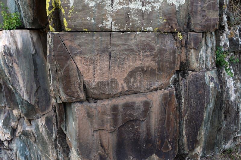 Rock petroglyphs in the tract Kalbak-Tash. ALTAI REPUBLIC, RUSSIA - JUNE 8, 2018: Rock petroglyphs in the tract Kalbak-Tash. Petroglyphs of different historical stock photo