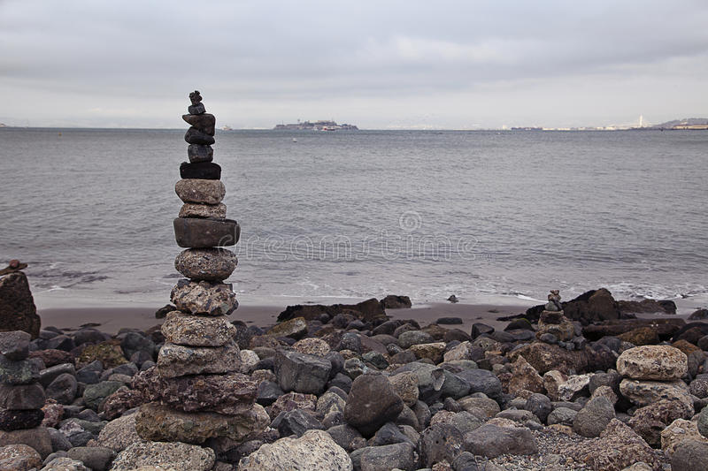 Rock Pile. A rock pile with Alcatraz island in the distance on a cloudy day royalty free stock photos