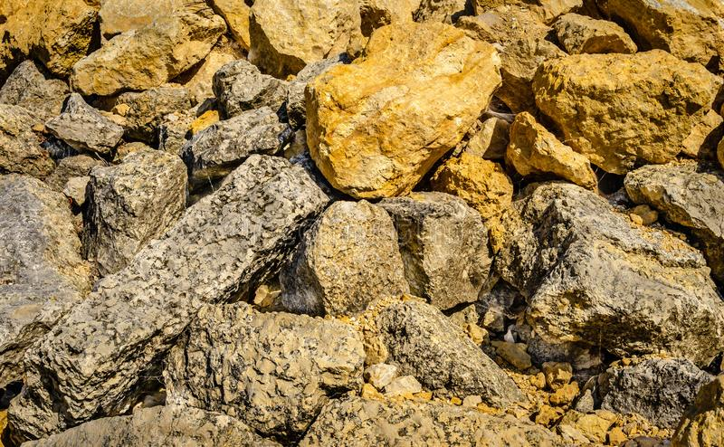 Rock pile detail abstract background of random stone. Rock pile detail of random piled large natural stone; abstract background stock photography