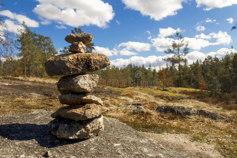 Rock pile in the finnish forest. Rock pile in the foreground and forest in the background in finland during summer stock photos