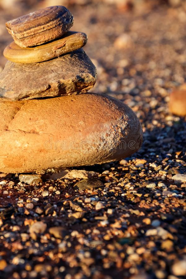 Rock pile and gravel. Rusty Rock pile and gravel in sunset royalty free stock photo