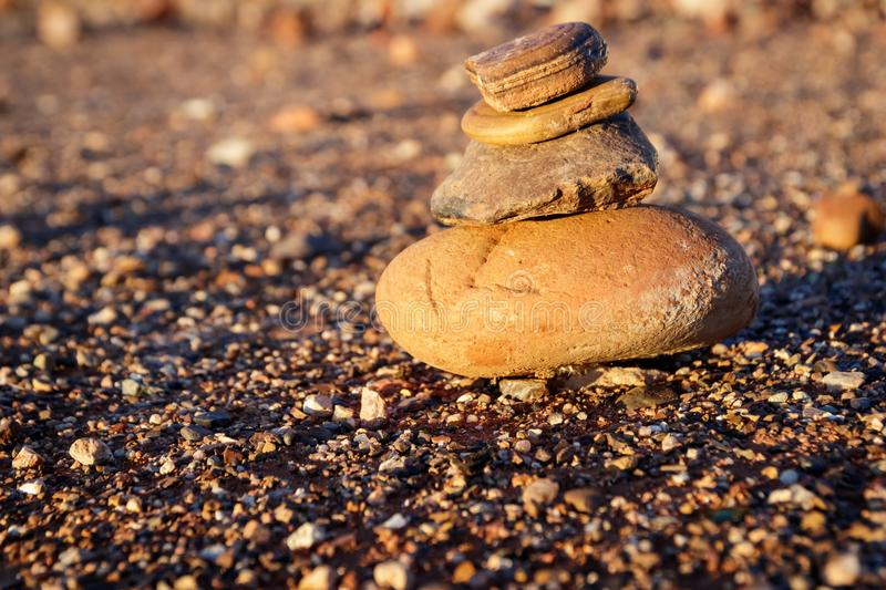 Rock pile and gravel. Rusty Rock pile and gravel in sunset stock photo