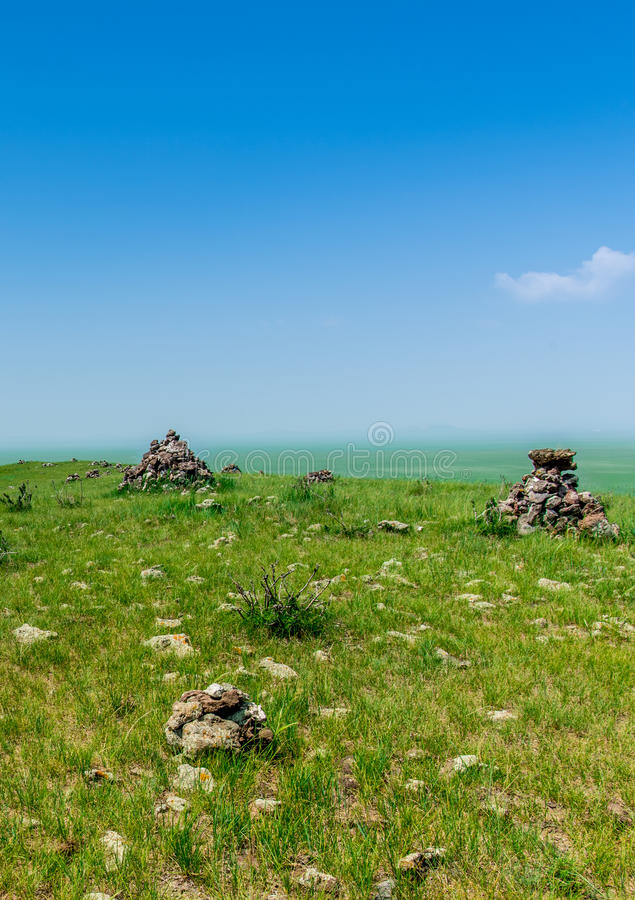 Rock pile. In the meadow stock images
