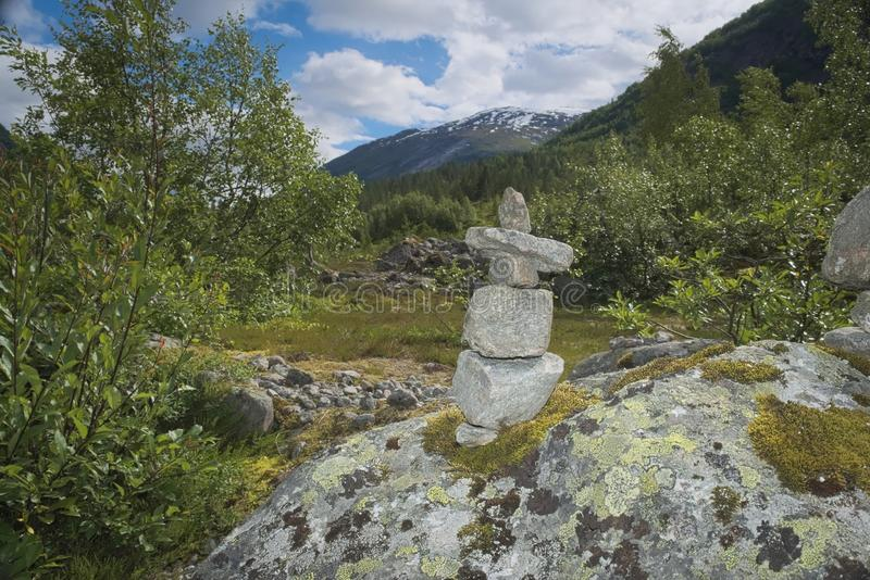 Rock pile in scenic mountains. This rock pile looks like a little person with a hat on. Set among the mountains and the natural landscape royalty free stock photos
