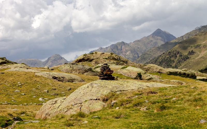 Rock Pile Amidst the Mountains. A rock pile signaling a path along a mountain range stock images