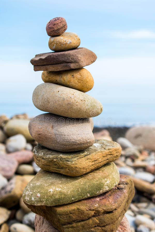 A rock pile or stack, with a blue sky as a background. Shows balance stock photography