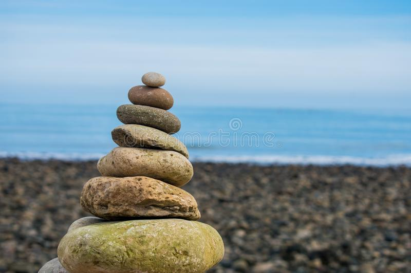 A rock pile or stack, with a blue sky as a background. Shows balance royalty free stock image
