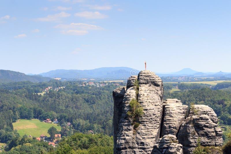 Rock pinnacle Monch with weather vane near Rathen in Saxon Switzerland. Germany royalty free stock image