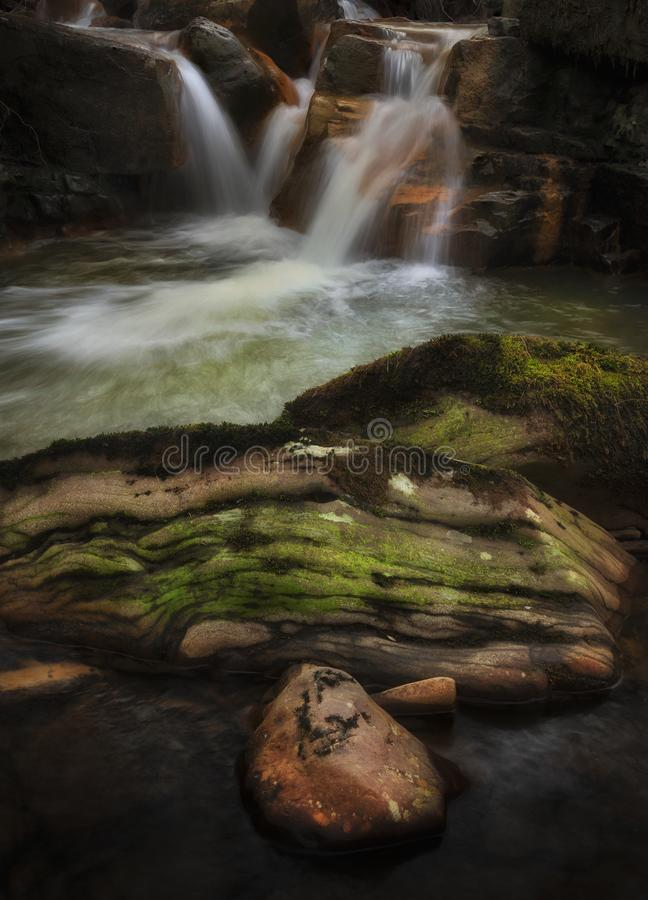 Rock pool at Melincourt Brook falls. Waterfall and stones on the river at Melincourt Brook in Resolven, South Wales, UK stock photo