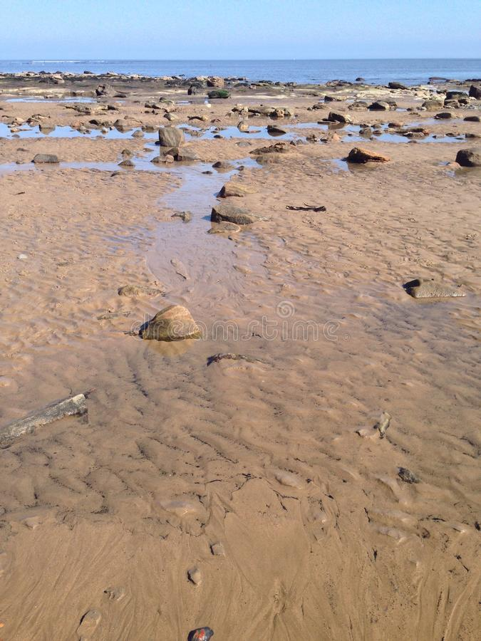 Rock pools and rocks on the beach stock images
