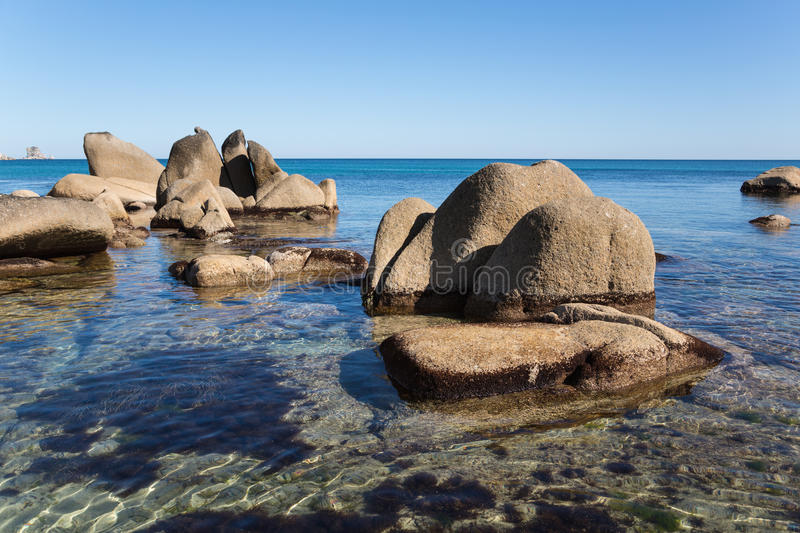 Rock protruding from the sea. royalty free stock photos