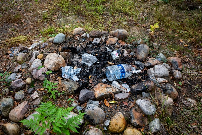 Campfire with trash on public land. stock photos