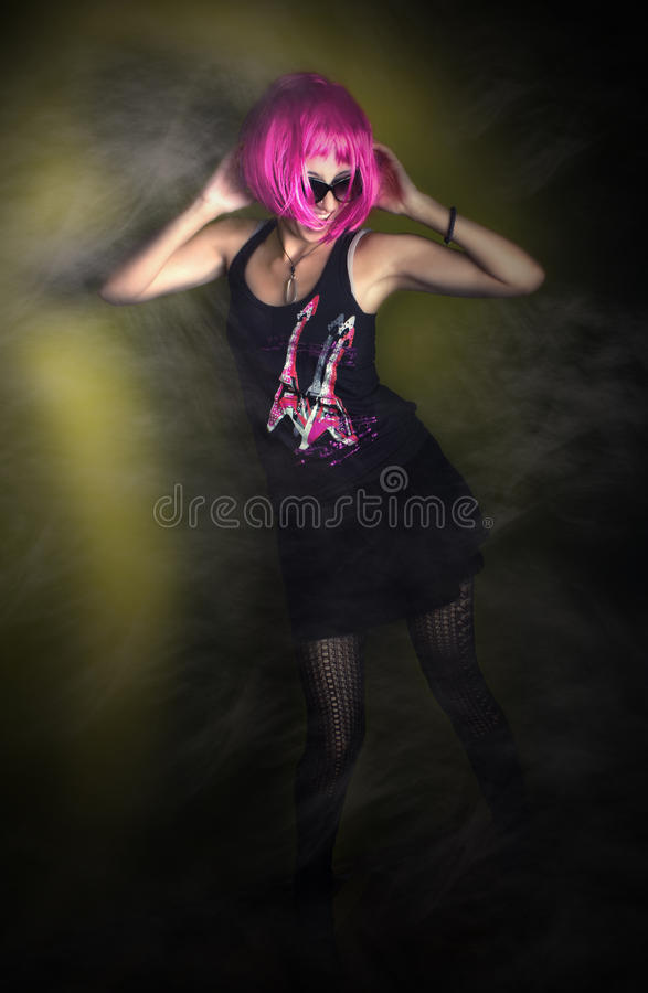 Rock and roll girl dancing in the night club stock photo