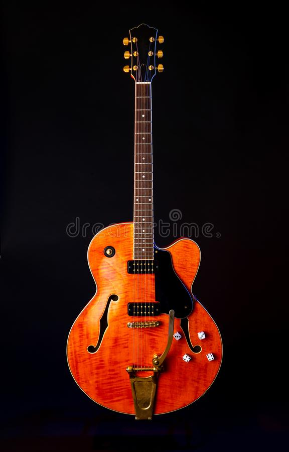 Vintage Electric Guitar, Orange flame maple, 6 String isolated on black. Rock and Roll Guitar, 6 string electic, solid body, single cutaway stock photo
