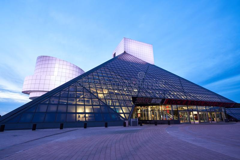 Rock and Roll Hall of Fame Entrance. Cleveland, Ohio/USA - March 5th 2018: The Rock and Roll Hall of Fame in the evening lit up with lights and a blue sky in the royalty free stock photography