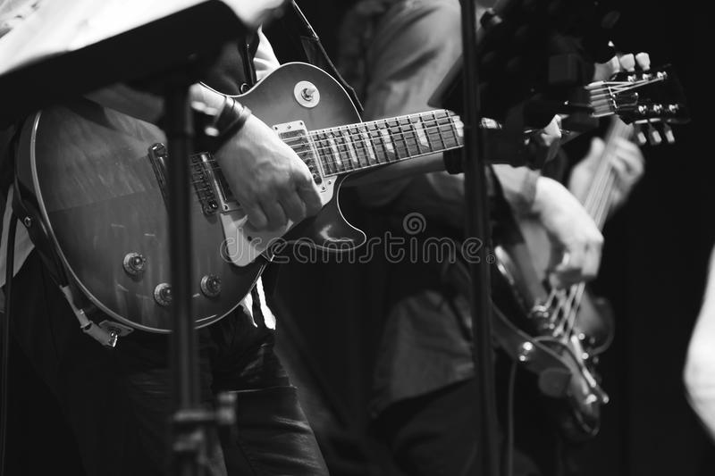 Rock and roll music background, guitar players stock photos