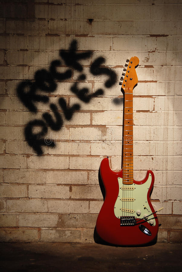 Rock rules with red guitar. royalty free stock images