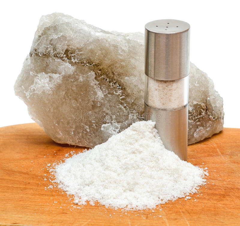 Rock salt with saltshaker and scattered salt stock photography