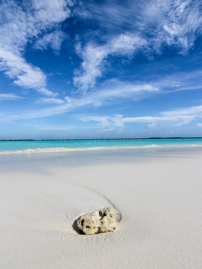 Rock on sandy beach