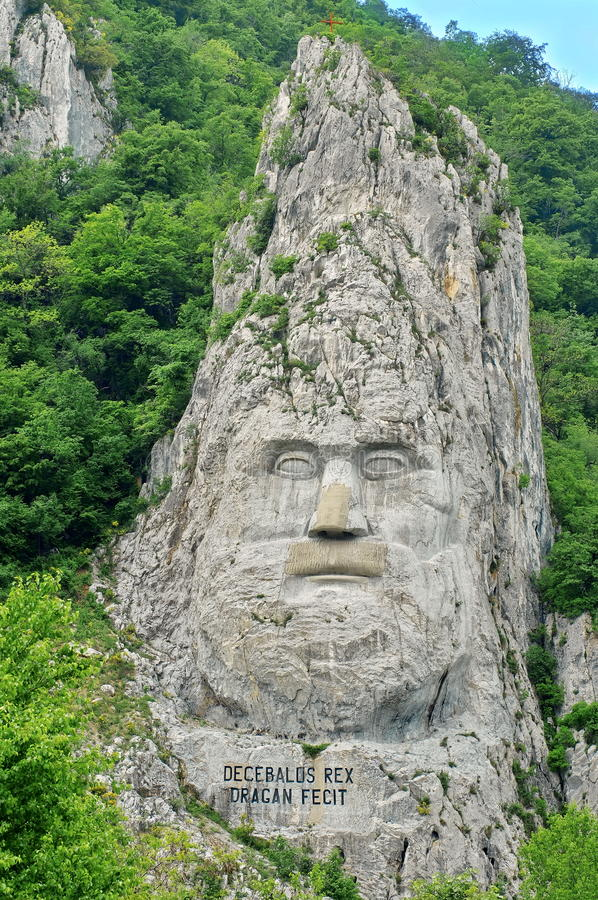 The Stone Statue of Decebalus, king of the Dacians, at the Iron Gates, on Danube River - landmark attraction in Romania royalty free stock photos