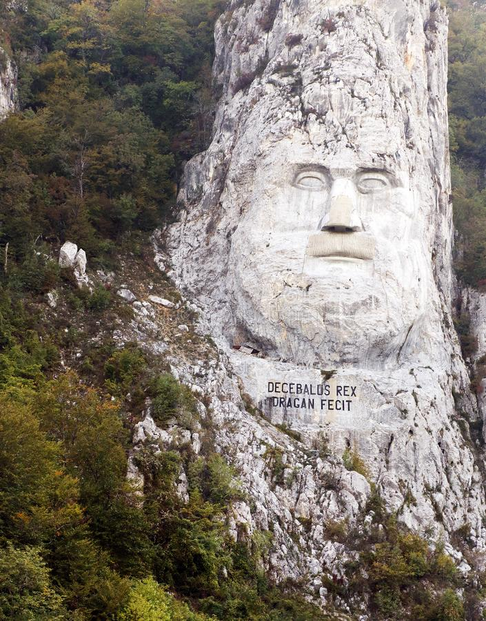 The rock sculpture of Decebalus the last king of Dacia carving in rock, on the river Danube, at the Iron Gates stock images