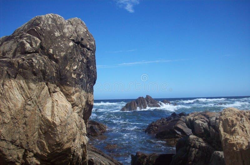 Rock_in_sea fotos de archivo