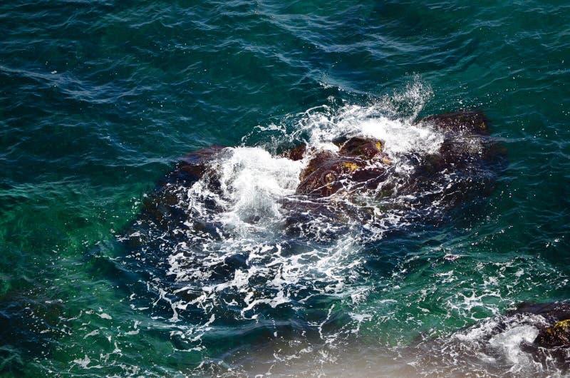 Rock in the sea stock photos