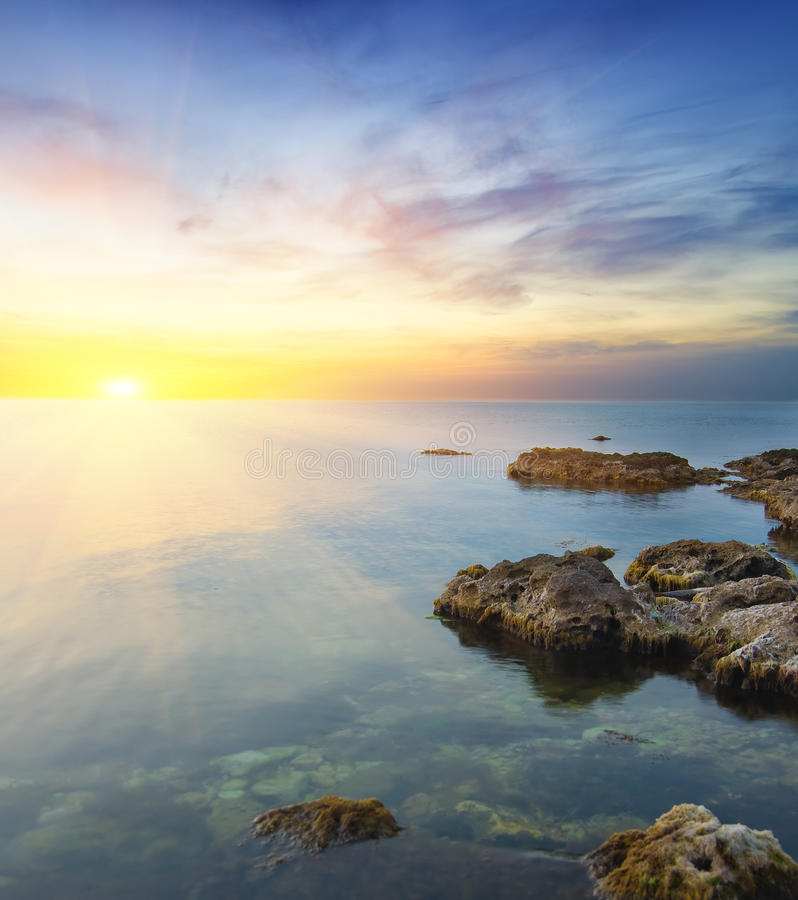 Rock in sea on sunset. royalty free stock image