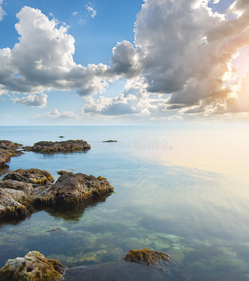 Rock in sea on sunset. stock photography