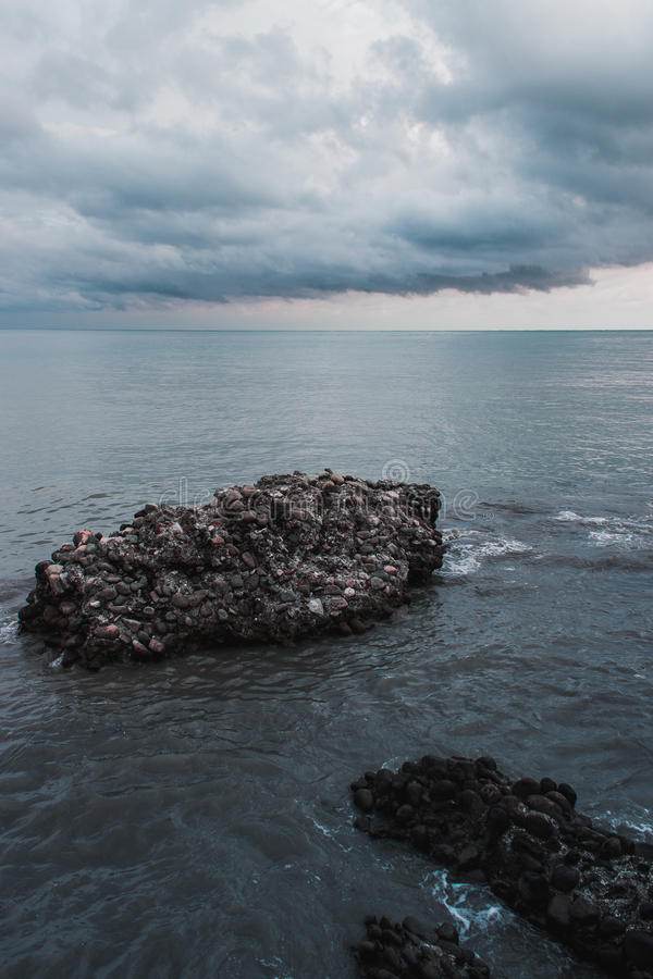 Rock in the sea royalty free stock photos