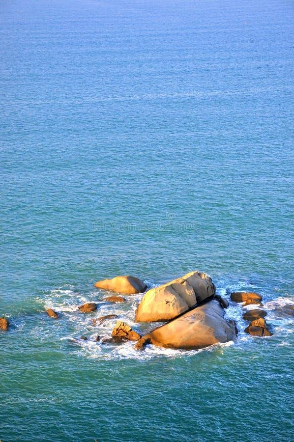 Rock and sea water in sunrise lighting