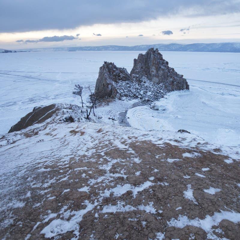 Rock Shaman. Lake Baikal, winter. Cape Burhan landscape. stock photo
