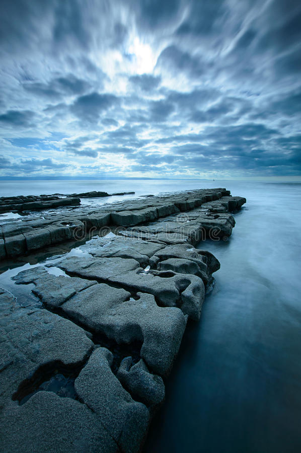 Rock Shelf at Nash Point. A protruding rock shelf at Nash Point, on the Glamorgan Coast, Wales royalty free stock images
