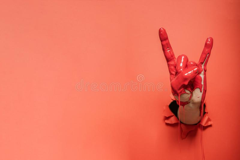 Rock sign gesture painted with red paint stock photography
