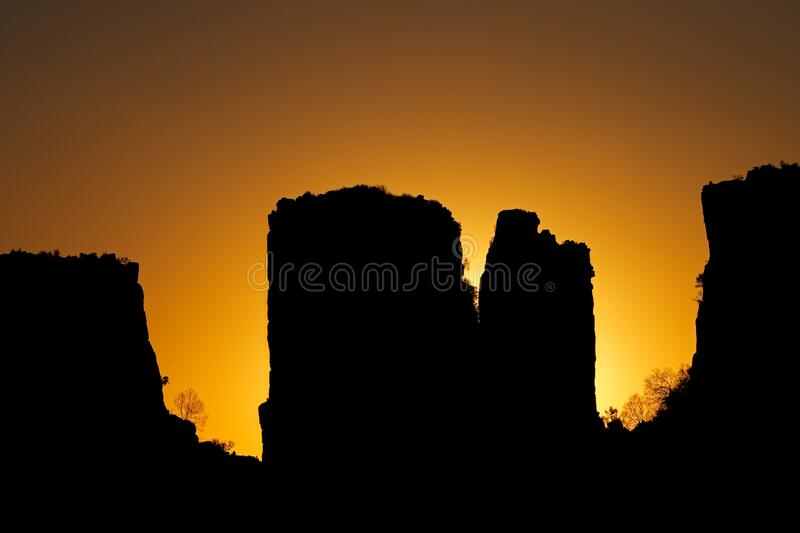 Valley of desolation at sunset - South Africa. Rock silhouettes at sunset, Valley of desolation, Camdeboo National Park, South Africa stock image