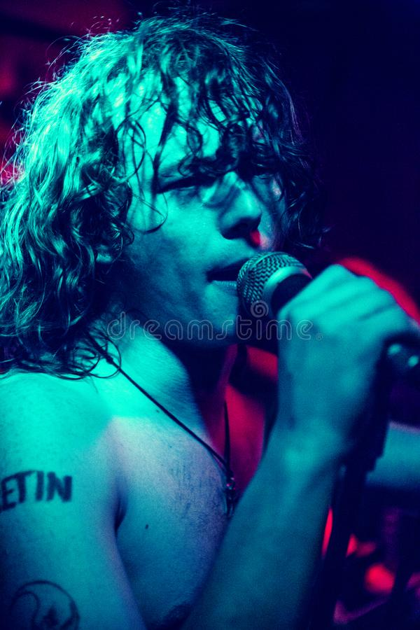 Rock singer during a live concert stock photo