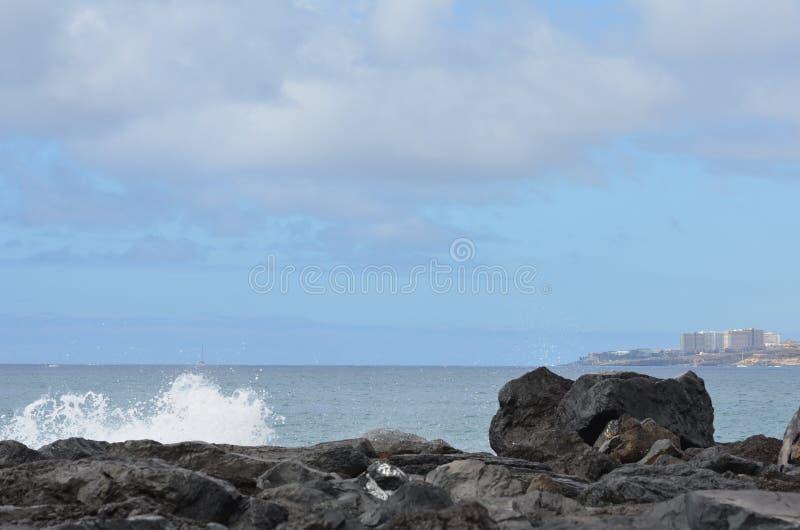 Rock;sky;ocean;splashes royalty free stock photography