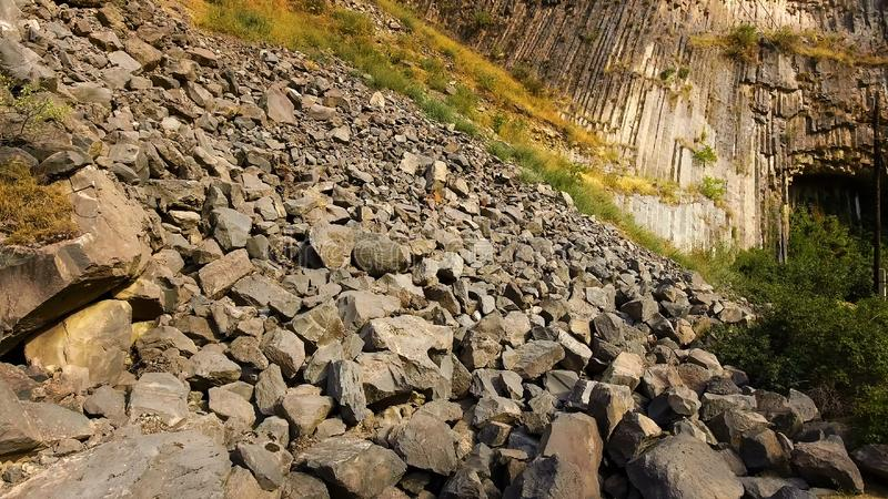 Rock slides and stones scattered over hills, risk of mudflow, geology science stock images