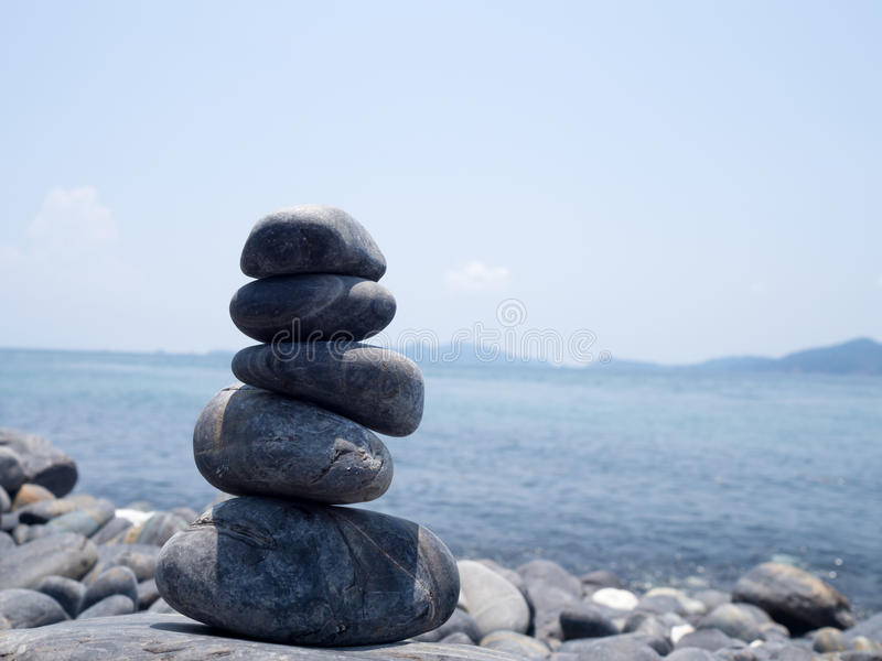Rock stacked, stones stack on the coast of the Sea in the nature. Life balance, spa stones treatment scene concept. Stones on Hin royalty free stock images