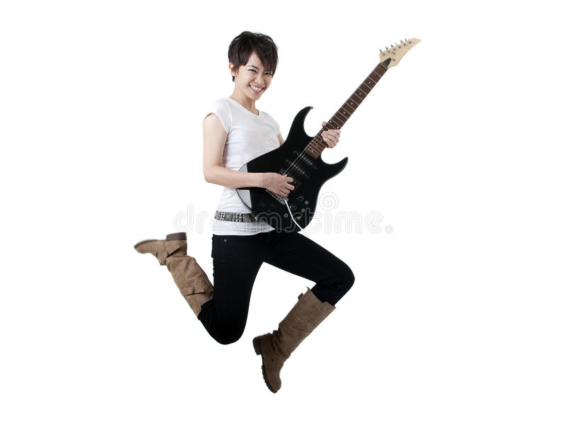 Rock star. Asian female rock star jumping with isolated white background stock images