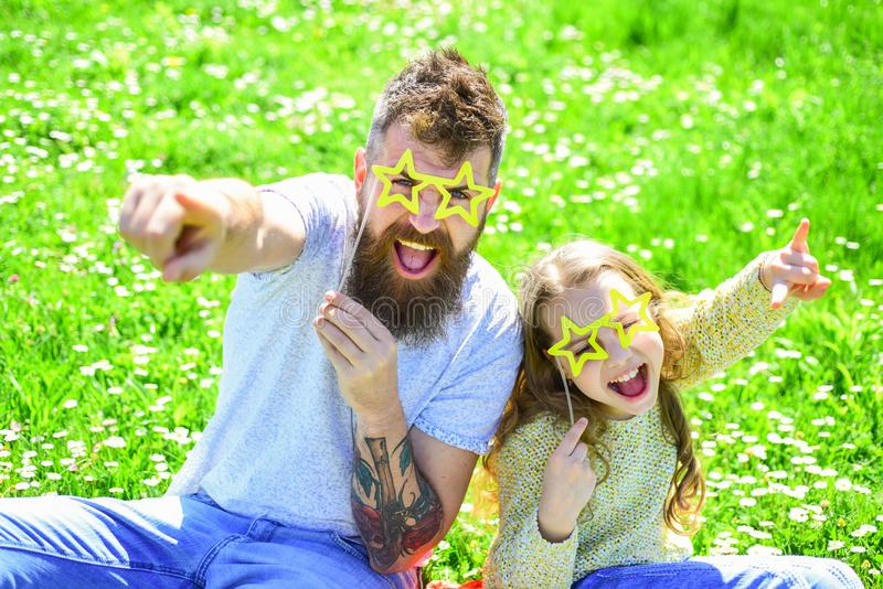 Rock star concept. Family spend leisure outdoors. Child and dad posing with star shaped eyeglases photo booth attribute stock images