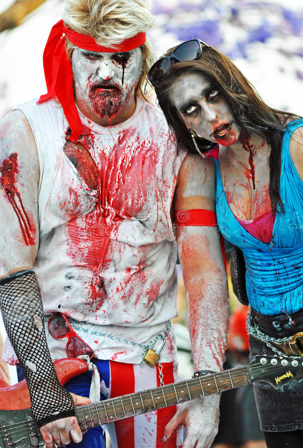 Rock star & crazy fan woman groupie zombies in famous annual Zombie Walk event Brisbane City, Australia stock photos