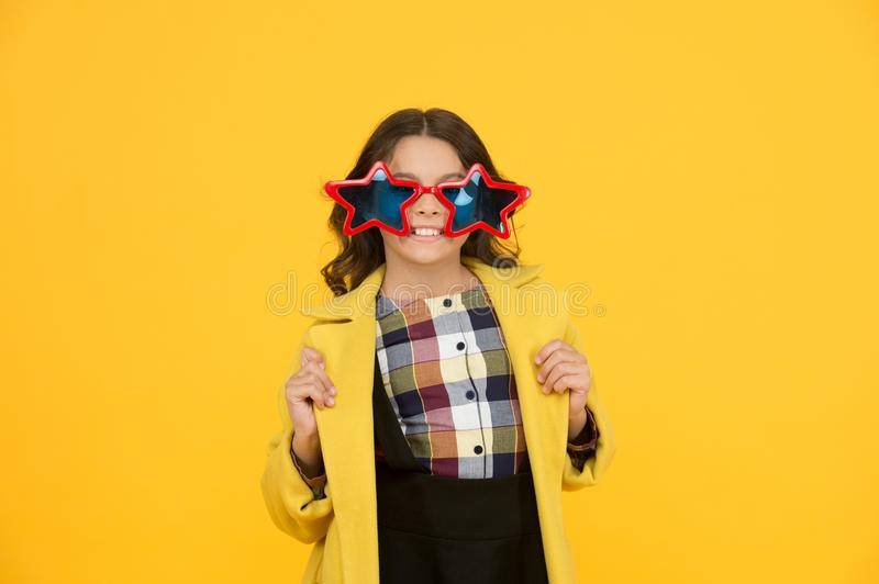 Rock star. Feeling like a superstar. Girl confident cool kid wear star shaped sunglasses. Star concept. Fame and. Popularity. Party holiday celebration stock photo